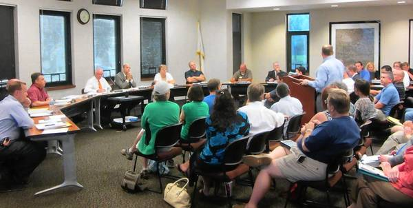 Residents packed the meeting room at Lake Zurich police headquarters after the board's regularly scheduled meeting was moved due to flood damage village hall sustained last week.