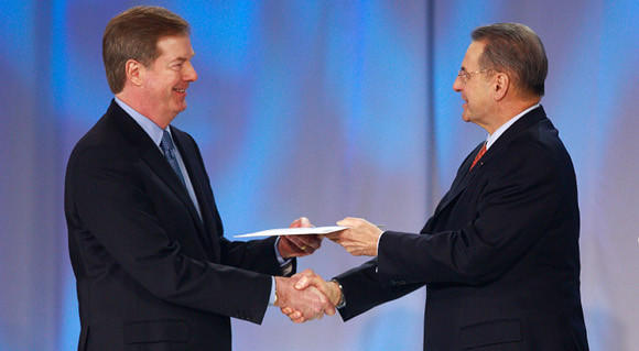 U.S. OIympic Committee chairman Larry Probst (left) receives the U.S. invitation to the 2010 Winter Olympics from International Olympic Committee president Jacques Rogge.  (Jeff Vinnick/Getty Images)