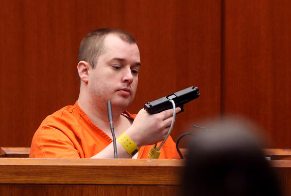 Gunman Jacob Nodarse holds the gun he used to shoot and kill Michael Kramer, 20, and Kramer's parents, Jeffrey, 50, and Lori, 48, during cross-examination by Defense Attorney Richard Kling in the trial of Johnny Borizov in a DuPage County courtroom on April 26, 2013.