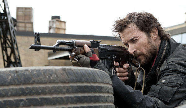 "Noah Wyle fights the alien invaders in ""Falling Skies."""