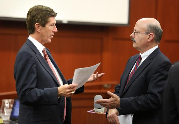 Prosecutor Bernie de la Rionda, right, talks to defense attorney Mark O'Mara in the courtroom in Sanford, Fla. O'Mara is representing George Zimmerman, who is charged with second-degree murder for the 2012 shooting death of 17-year-old Trayvon Martin.