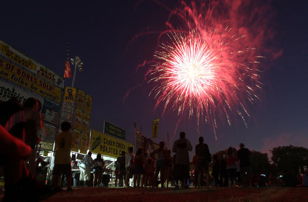 Fireworks explode over the crowd Tuesday, July 3, 2012 at Ribfest in Naperville.