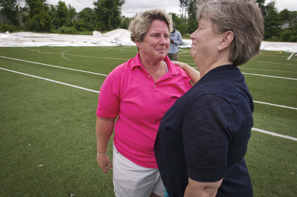 Kathy Russotto of Sports World in East Windsor meets with First Selectwoman Denise Menard on Tuesday. Russotto took Monday's tornado warning seriously and led 20 people from Sports World's inflatable dome to shelter in another building just before a tornado destroyed the dome. (Mark Mirko / Hartford Courant)