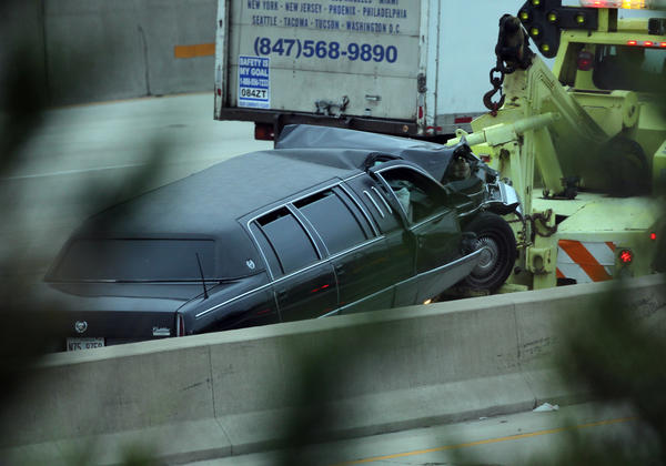 A limousine is towed away after being involved in an accident on the Dan Ryan Expressway in Chicago.