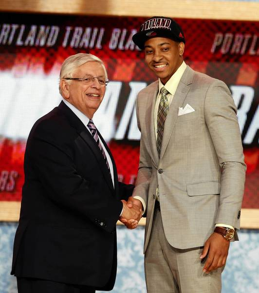 C.J. McCollum (R) from Lehigh University shakes hands with NBA Commissioner David Stern after being selected by the Portland Trail Blazers as the 10th overall pick in the 2013 NBA Draft in Brooklyn, New York, June 27, 2013.