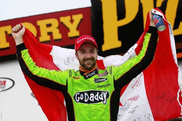 James Hinchcliffe of Canada driver of the #27 GoDaddy Andretti Autosport Chevrolet celebrates in victory lane following his victory in the Iowa Corn Indy 250 at Iowa Speedway on June 23, 2013 in Newton, Iowa.