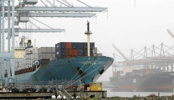 "A container vessel is off-loaded in the Port of Los Angeles. ""The largest port in the U.S. has not conducted a cyber security vulnerability assessment, nor does it have a cyber incident response plan,"" a Coast Guard commander wrote of the port."
