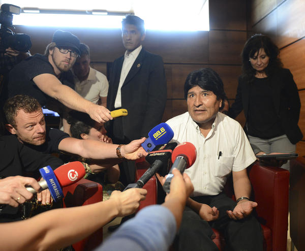Bolivian President Evo Morales talks to journalists Wednesday at Vienna International Airport after his plane from Russia was forced to land there amid suspicion that fugitive that U.S. intelligence leaker Edward Snowden was on board.