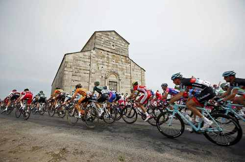 The pack of riders cycles on its way during the 213 km first stage of the centenary Tour de France cycling race from Porto-Vecchio to Bastia, on the French Mediterranean island of Corsica June 29, 2013.