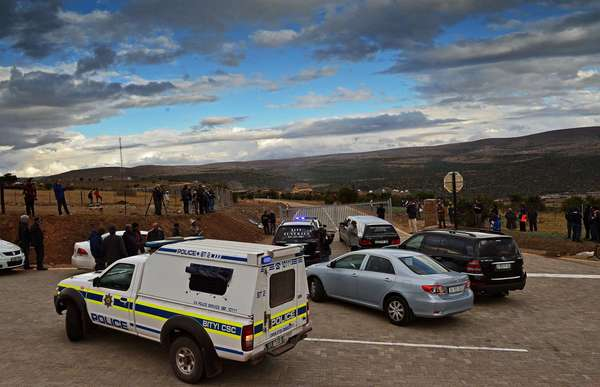 A police convoy and a hearse arrive at Mvezo resort on Wednesday to collect the remains of former South African President Nelson Mandela's children.