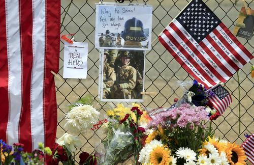Firefighter Kevin Wyjeck is remembered with pictures on the fence surrounding Fire Station 7 in Prescott.
