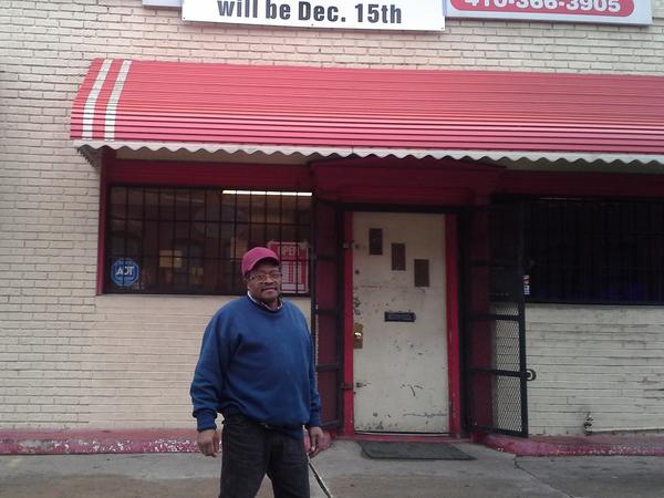 Owner James Atkinson stands outside Mr. James Tire Store, also known as James and Lynn Tire Service. Atknson is retiring Dec. 15 and closing the store. He has sold the building to Seawall Development Corp., which plans to redevelop it for use by a theater company, a restaurant and an arts-oriented nonprofit group.