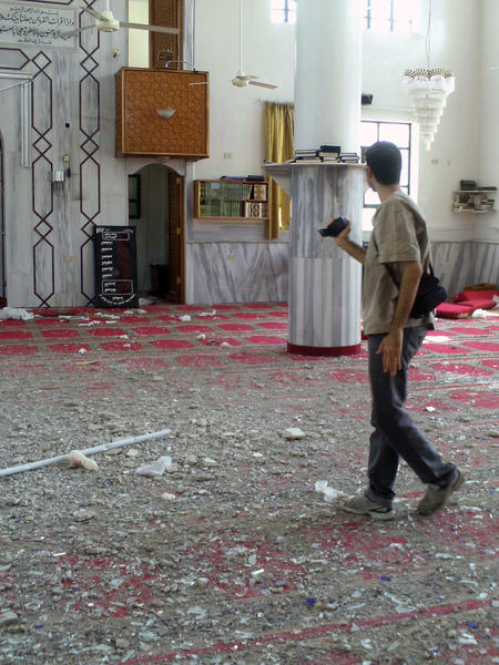 Activist Adnan Sheikh films damages to a mosque in June 2012 after repeated shelling by government forces in Moadamyeh, Syria.