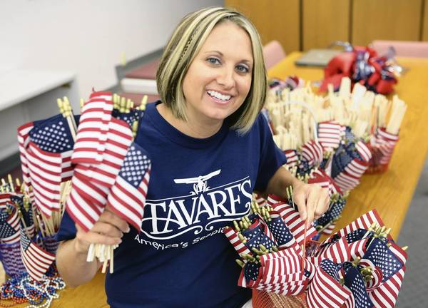 Valerie Madden poses with flags at Tavares CIty Hall on Tuesday, July 2, 2013. The city of Tavares will hand out 2,000 American Flags before the Fourth of July parade that will begin on Main Street at 4 p.m. Thursday.