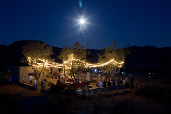 The high desert moon, with assists from string lights and the photographer's shutter speed and aperture setting, captures the glow of Paul Goff and Tony Angelotti's recent summer solstice party at the Ruin.