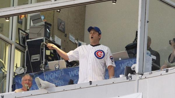 "Actor Vince Vaughn sings ""Take Me Out to the Ballgame"" during the 7th-inning stretch at in June 2012."