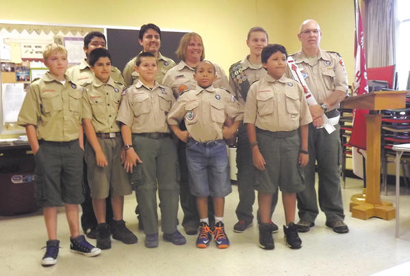 Front row, from left, Logan Toms, Brendan Heisler, Sean Maguire, Devonte Johnson and Joshua Macias. Back row, Kevin Macias, Noel Macias (Assistant Scoutmaster-Lion Patrol), Michele Taylor (Assistant Scoutmaster-Dove Patrol), Ryan Maguire and Bill Taylor (Scoutmaster).