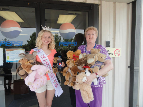 Tonya Youngblood, right, of Pepsi Beverages Co. in Williamsport, organized a charity effort for employees to donate stuffed animals for Miss Washington County Outstanding Teen Taylor Ammons' Bears for Kids program.