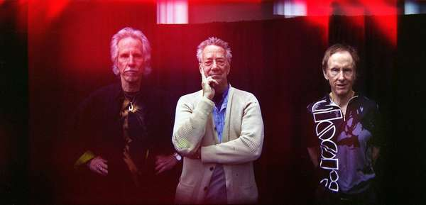 John Densmore, left, Ray Manzarek and Robby Krieger of the Doors appear in a triple exposure composite photo from 2010