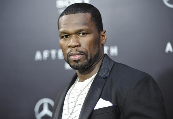 Rapper 50 Cent, born Curtis Jackson, has been charged in connection with a domestic violence incident involving his ex-girlfriend.