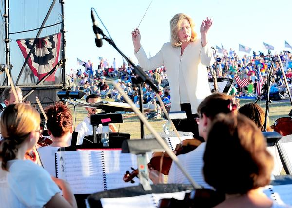 Maryland Symphony Orchestra Musical Conductor Elizabeth Schulze leads the MSO in 2010 during the 25th annual Salute to Independence at the Antietam National Battlefield. The 2013 concert is Saturday, July 6.