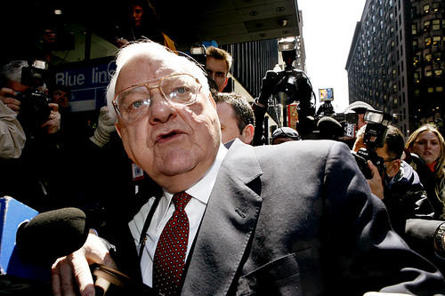 Former Gov. George Ryan makes his way past photographers and reporters as he leaves the Dirksen U.S. Courthouse in Chicago after being found guilty of corruption.