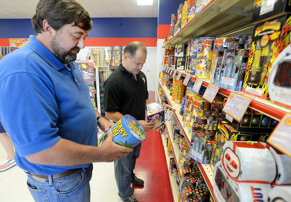 Robert Smith, left, of Greencastle, and Jason Willhite of Hagerstown, were looking over some of the thousands of fireworks for sale Tuesday at the Keystone Fireworks Greencastle Superstore.