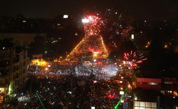 Opponents of ousted Egyptian President Mohamed Morsi celebrate outside the presidential palace in Cairo.