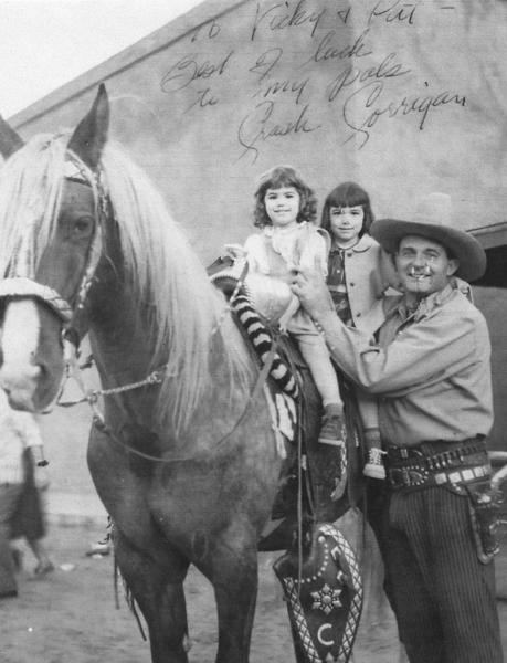 Victoria Baima Mandile, right, and her sister Pattie, left, met Ray Crash Corrigan, star of a number of westerns, at Corriganville, an amusement park on his ranch in Simi Valley. The buildings were destroyed by a 1970 wildfire, but the city of Simi Valley recently bought a portion of the property and developed it as a park.