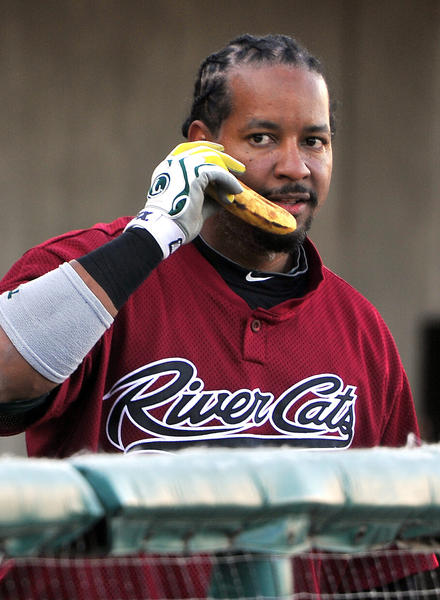 Sacramento River Cats' Manny Ramirez plays around as if he's taking a call with a banana before a game in 2012.