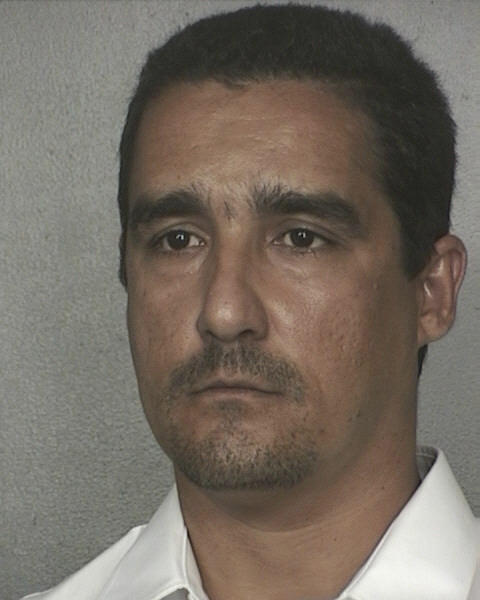 Flavio Santisteban original booking photo at the Broward County Jail in 2005 after he was arrested and accused of killing four people in a fiery crash involving his fuel tanker truck.