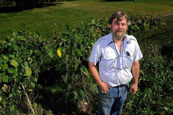 Wayne Sabaj stands in his garden in 2011 shortly after discovering bags of cash there.