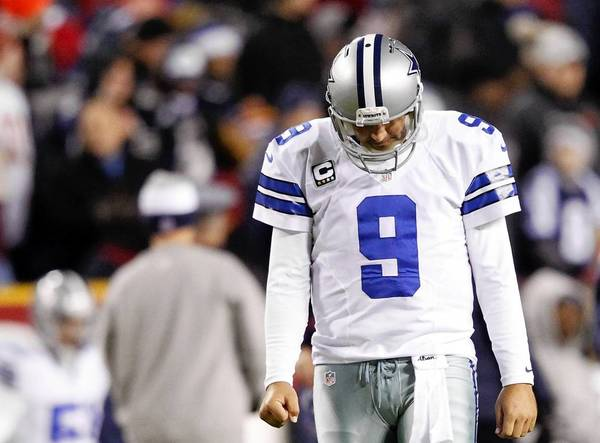 Dallas Cowboys quarterback Tony Romo (9) makes his way back to the field during a break in play as the Washington Redskins beat the Dallas Cowboys 28-18, Sunday, December 30, 2012 in Landover, Maryland.
