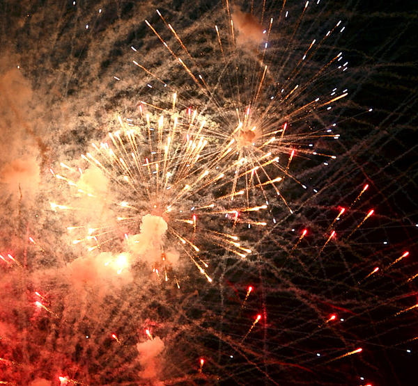 The fireworks display begins with multiple bursts of red at the Plumb Grove Mansion Independence Eve event in Clear Spring Wednesday.