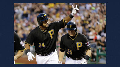 Pittsburgh Pirates' Pedro Alvarez (24) celebrates as he returns to the dugout with teammate Russell Martin (55) who also scored on his three-run home run off Philadelphia Phillies starting pitcher John Lannan during the fifth inning of a baseball game in Pittsburgh, Wednesday.