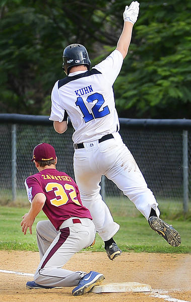 Valley's T.J. Kuhn (12) is safe at first as Maugansville first baseman Zach Zawatski (32) corrals the late throw in the fourth inning of Wednesday's Maryland District 1 Senior Tournament championship game.