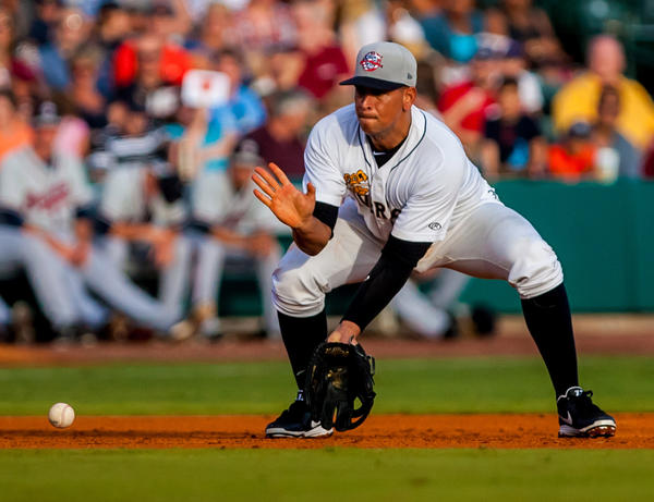 Alex Rodriguez, as part of the Charleston RiverDogs, fields a grounder in the third inning of a rehab game against the Rome Braves at Joseph P. Riley, Jr. Park.