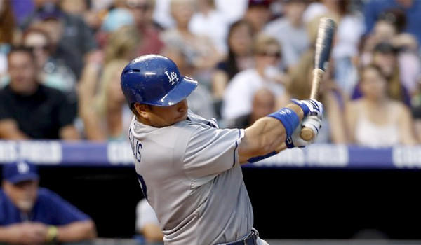 A.J. Ellis drives in Hanley Ramirez with a two-out RBI single in the fourth inning of the Dodgers' win over the Colorado Rockies, 10-8.