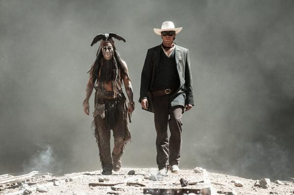 "Johnny Depp, left, and Armie Hammer star in ""The Lone Ranger."""
