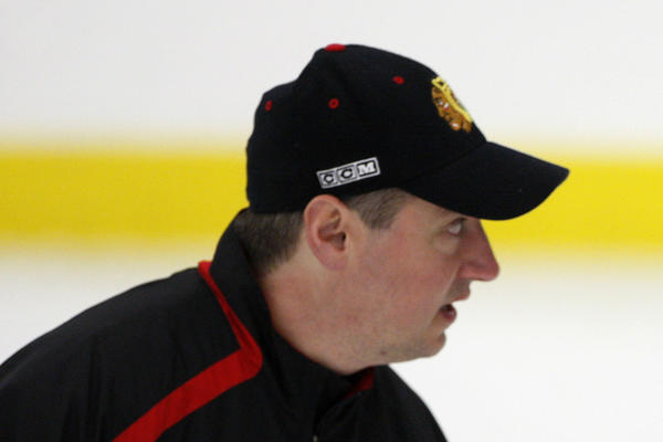 In this 2010 photo, then-Chicago Blackhawks goaltender Antti Niemi listens to goaltending coach Stephane Waite during practice at Johnny's Ice House.