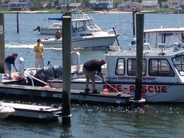 Police and fire crews recovered a body from the harbor in Clinton Thursday morning.