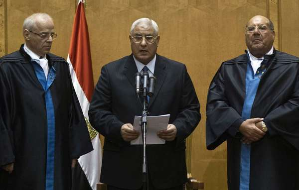 Adly Mahmoud Mansour, head of Egypt's Supreme Constitutional Court, takes the oath of the presidency in a court chamber in Cairo.