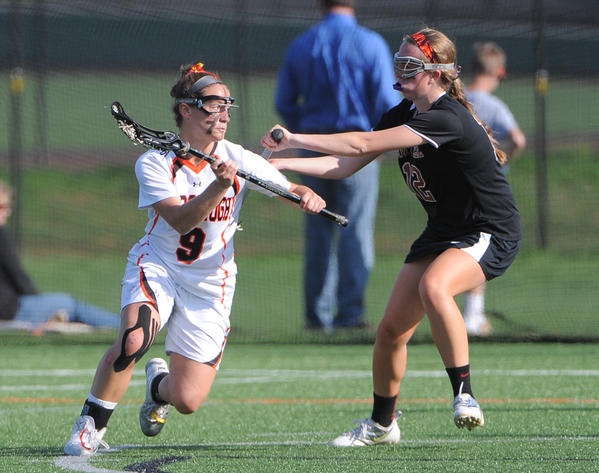 McDonogh's Sammie Burgess controls the ball in a game against Maryvale in April.