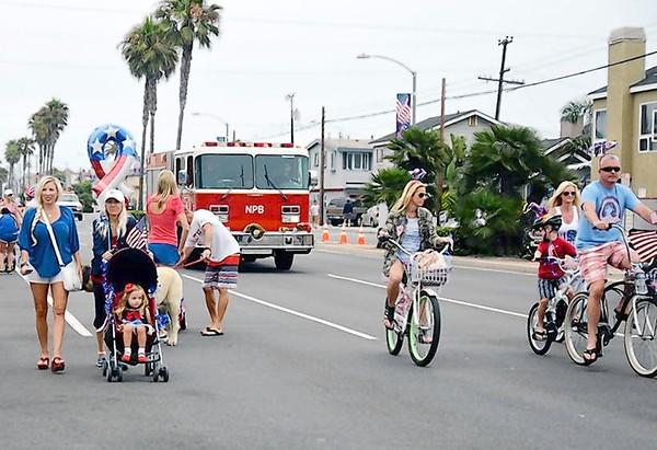 Ethan Ramos, 2, of Rowland Heights, rides in a homemade space shuttle down West Balboa Boulevard in the 4th of July is for Families parade on Thursday.