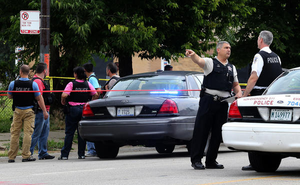 Chicago police investigate the scene of a police-involved shooting in the 5600 block of south State Street.