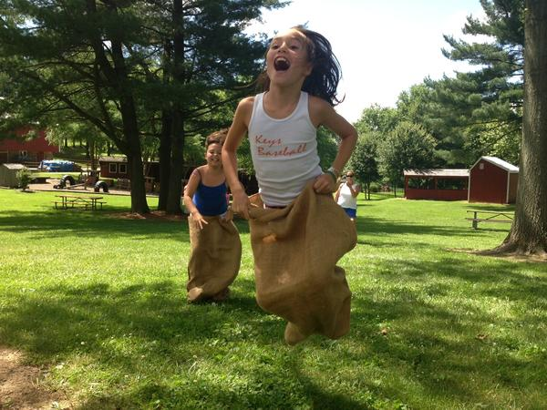 Ellie Byram, 9, performs in the sack races at the Old-Fashioned Fourth of July Celebration at the Carroll County Farm Museum on July 4, 2013. Behind her is her cousin, Lily Armstrong, 10.