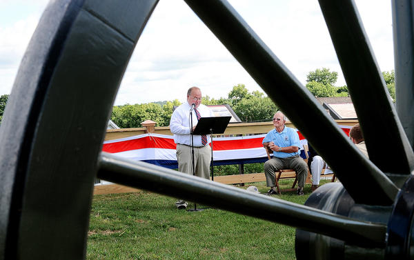 Williamsport Councilman Scott Bragunier speaks at a dedication of cannons on Doubleday Hill in Willamsport Thursday while Washington County Commissioner William McKinley listens.