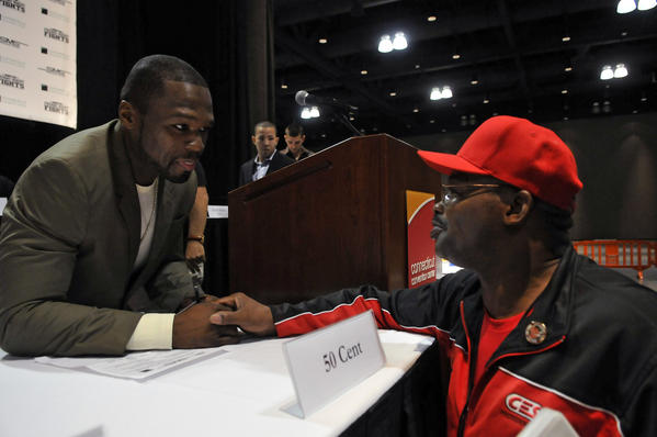 50 Cent, left, talks with Hartford boxing legend Marlon Starling after 50 formally announced the July 5 ESPN Friday Night Fights show at the Connecticut Convention Center. 50 Cent is the promoter of the boxing event, which will feature some boxers from Hartford and New Haven.