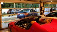 At trophy homes for sale, high-end cars are featured attractions