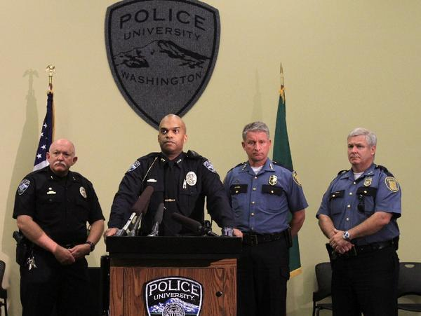 University of Washington Police Chief John Vinson, second from left, discusses the arrest.